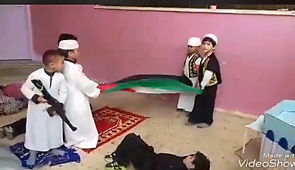 "From the children's performance: the children ""overcome"" the ""Israeli security forces"" on the Temple Mount, take their weapons and kill them (Facebook page of the al-Huda kindergarten, December 19, 2017)."