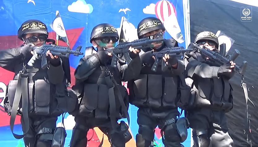 Performance in a kindergarten simulates killing Orthodox Jews. An ordinary children's picture is behind the children, who are dressed in uniforms and armed with rifles, knives and guns Orthodox Jews (YouTube, May 29, 2017).