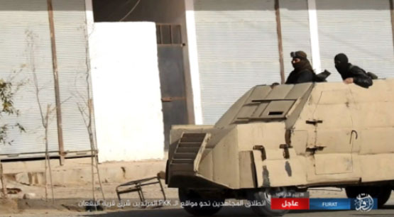 ISIS operatives in a self-manufactured armored off-road vehicle moving towards SDF positions in the village of Al-Buqan.