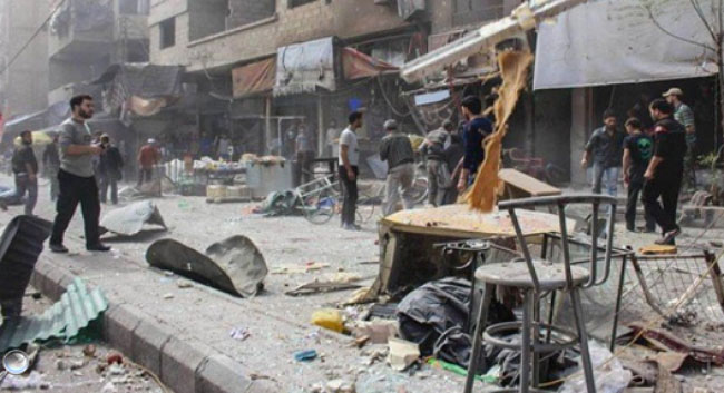 The scene of the double suicide bombing attack in Al-Tayaran Square in central Baghdad.