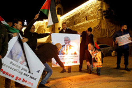Palestinian activists in front of the Church of the Nativity in Bethlehem burn pictures of American Vice President Mike Pence (Twitter account of Palinfo, January 22, 2018).