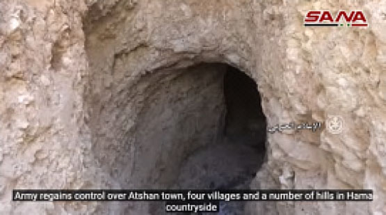 Entrance to a cave used by operatives of the Headquarters for the Liberation of Al-Sham while staying around the village of Atshan (SANA's YouTube channel, December 30, 2017).