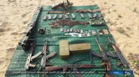 Weapons seized by ISIS, including cellular phones and ID cards of the soldiers (Akhbar Al-Muslimeen, December 30, 2017)