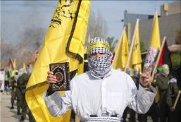 Masked operators wearing white shrouds and explosive belts. Each of them held a copy of the Qur'an (Facebook page of the Fatah student movement at Bir Zeit University, January 3, 2018).