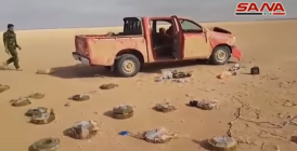 The vehicle with anti-tank mines around it (SANA's YouTube channel, January 4, 2018)