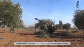 Operatives of the Headquarters for the Liberation of Al-Sham firing field artillery at Syrian army positions in the village of Khreibeh (Ibaa News Agency, which is affiliated with the Headquarters for the Liberation of Al-Sham, January 11,