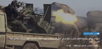 Operative of the Headquarters for the Liberation of Al-Sham firing a 23mm four-barrel anti-aircraft gun mounted on an SUV, at positions of the Syrian forces in the village of Khreibeh (38 km southeast the Abu Ad-Duhur military airbase).