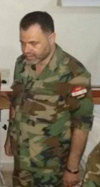 Engineer Mohammad al-Sa'id, founder and commander of the Al-Quds Brigade, visiting wounded fighters (Facebook page, August 9, 2014)