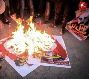 "Gazans burn pictures of Rami Hamdallah, prime minister of the national consensus government, and senior Fatah figure Hussein al-Sheikh during a demonstration protesting the lack of electricity. The Arabic on the picture reads, ""Traitor"" (official Fatah Facebook page, January 19, 2018)."