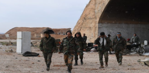 Syrian army soldiers near a hardened aircraft shelter in the Abu Ad-Duhur military airbase (SANA, January 22, 2018).