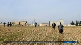 ISIS operatives moving towards the Syrian forces near Sinjar, southwest of the Abu Ad-Duhur airbase.