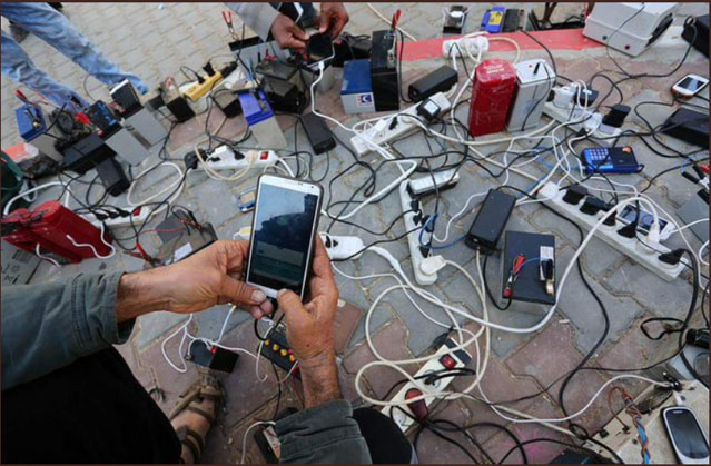 Results of the shortage of electricity: Gazans charge their phones using batteries in the street (Palinfo Twitter account, February 3, 2018).