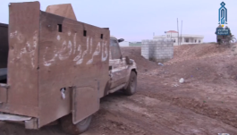 "Armored vehicle manufactured by the Headquarters for the Liberation of Al-Sham, with the inscription ""Defeater of the defiant."""