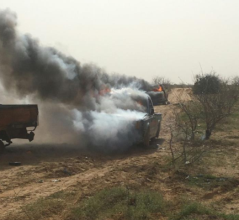 "Off-road vehicles of ""terrorist operatives"" which were set on fire by the Egyptian army in northern Sinai."