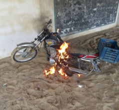 "A motorcycle belonging to ""terrorist operatives"" going up in flames after being found and set on fire by the Egyptian army in northern Sinai."