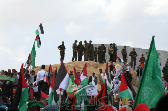 Palestinians hold a demonstration on the Gaza Strip side of the Rafah crossing.