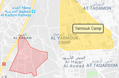 The area of the Palestinian Al-Yarmouk refugee camp, south of Damascus. At-Tadamon neighborhood is north of the camp. South of it is the city of Al-Hajar Al-Aswad. West of the camp is the Assali neighborhood, which is part of the Al-Qadam neighborhood (Google Maps). This area is partly controlled by ISIS.