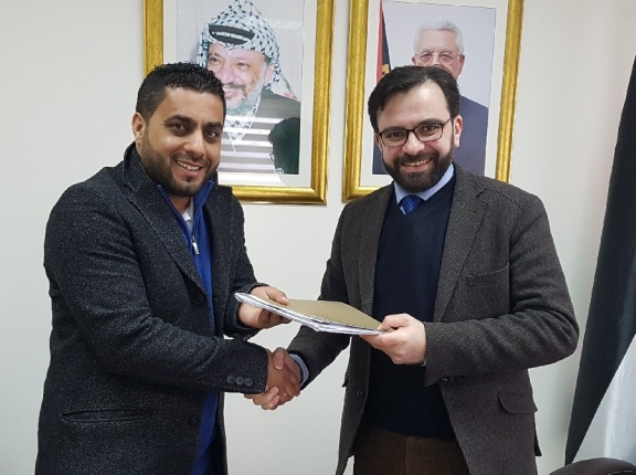The agreement was signed by Ihab Bseiso, Palestinian minister of culture (right), and Samer Jaradat, a musician with a recording company in Ramallah(website of the Palestinian ministry of culture, February 19, 2018)