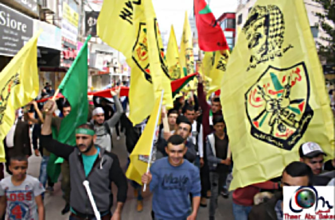 March held to commemorate Ahmed Nasr Jarar in Jenin. The marchers hold Fatah flags.
