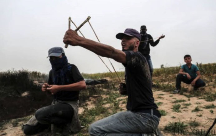 Palestinians riot near the border security fence in the Gaza Strip (Ma'an, March 23, 2018).