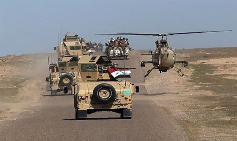 Iraqi army vehicles and helicopter during the operation against ISIS (Al-Sumaria, March 27, 2018)