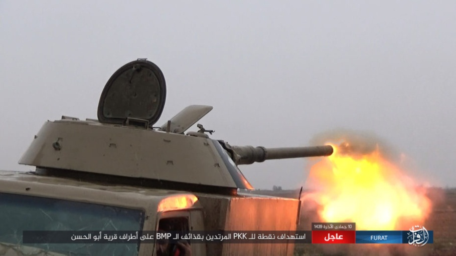 ISIS armored vehicle shells an SDF position north of Albukamal (Nasher, a file-sharing website, February 26, 2018)