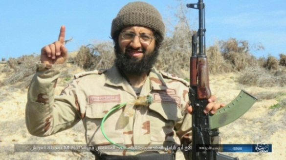 Abu Shamel al-Maqdisi. A green wire with a switch for activating the explosive belt at one end is visible in the photo.