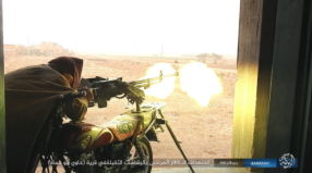 ISIS operative firing a machine gun mounted on a motorcycle, at SDF forces in the village of Hawi Abu Hamam, north of Albukamal (Haqq, December 22, 2017)