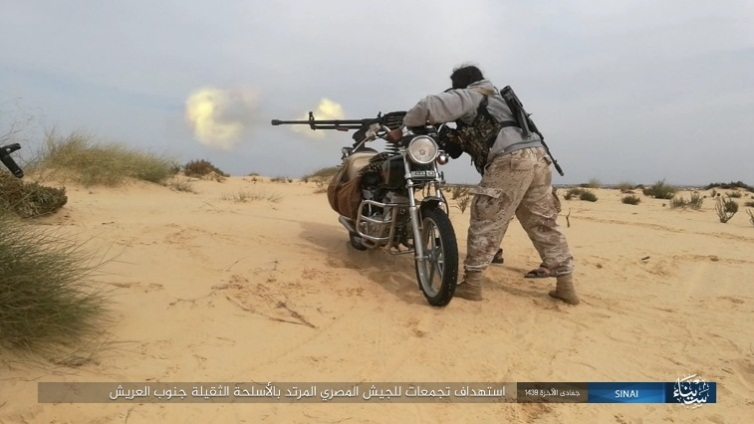 ISIS operative firing a heavy machine gun mounted on a motorcycle at an Egyptian Army staging zone south of Al-Arish (Akhbar al-Muslimeen, March 4, 2018)