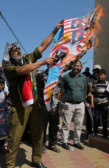Demonstration in Rafah where American and Israeli flags and a picture of Donald Trump were burned. Swastikas were drawn on the flags (Filastin al-A'an, and Palinfo, March 7, 2017).