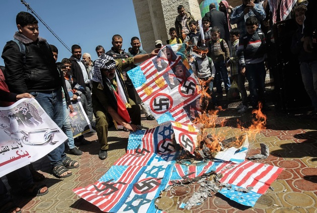-Demonstration in Rafah where American and Israeli flags and a picture of Donald Trump were burned. Swastikas were drawn on the flags (Filastin al-A'an, and Palinfo, March 7, 2017).