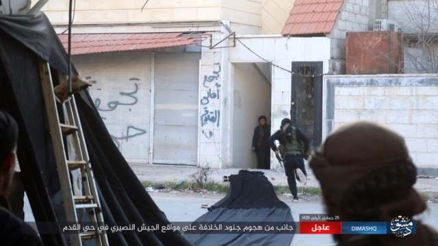 ISIS operatives advancing towards Syrian army positions in the neighborhood of Al-Qadam (Nasher, March 13, 2018)