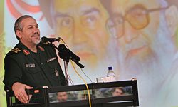 "Sayed Yahya Rahim Safavi during a speech in which he labeled Nasrallah as ""a soldier"" of Khamenei. In the background are photos of Khomeini and Khamenei (Fars, November 16, 2008)"