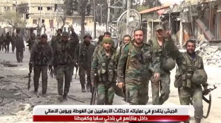 Syrian army soldiers in the city of Saqba, which was taken over from the rebels (SANA YouTube channel, March 18, 2018)