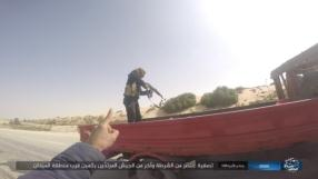 ISIS operative shooting a policeman and an Egyptian army soldier to death after they were stopped at a temporary checkpoint set up by the organization's operatives in west Al-Arish.
