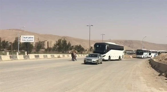 Buses which arrived to evacuate the rebels and their families through the Arbin Crossing towards Idlib (Suria Al-Hadath, March 25, 2018).