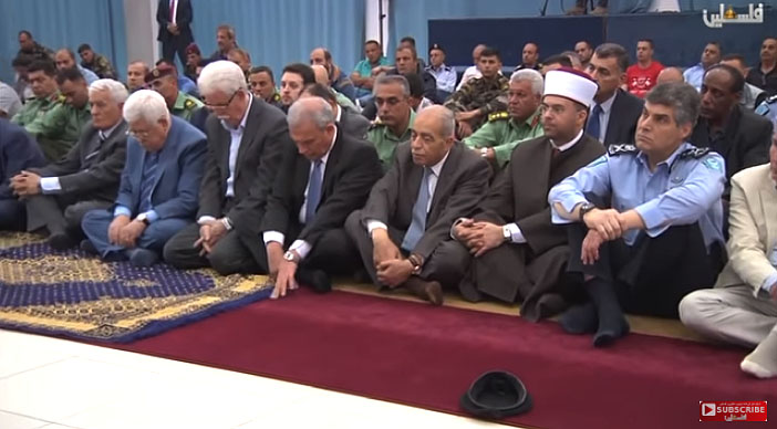 Mahmoud Abbas and other senior Fatah figures listen to the sermon (Palestinian TV YouTube channel, April 6 2018).