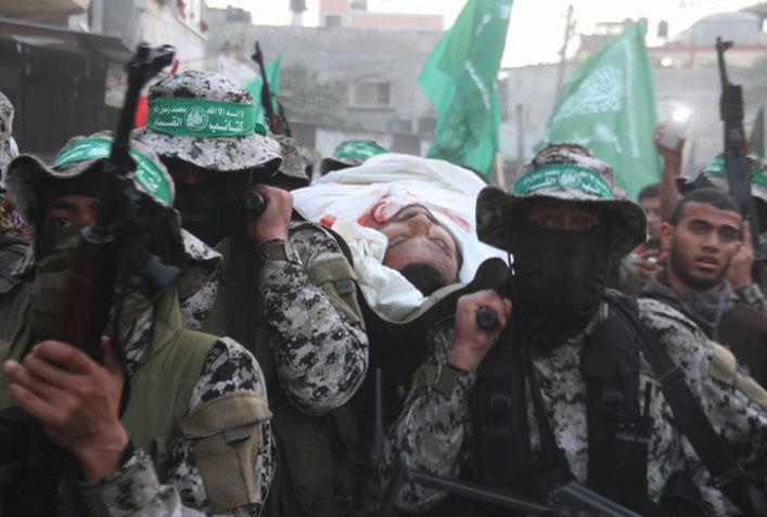 Operatives of the Palestinian police in the Gaza Strip and Hamas' military wing at the funeral of Majdi Shabat (Twitter account of Shehab, April 6, 2018).