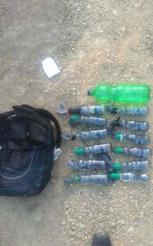 Bag of Molotov cocktails seized by the IDF from a Palestinian near the border security fence (Facebook page of Shams News, April 3, 2018).
