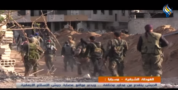 Syrian army soldiers on the southern route leading to the city of Duma (Sama, April 8, 2018)