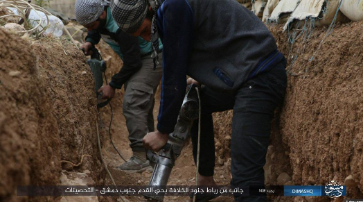 "ISIS operatives digging a trench and manning in positions in the Al-Qadam neighborhood in south Damascus, as part of the preparations for the attack of the Syrian army (ISIS's Damascus Province as quoted by the ""Al-Yarmouk Camp in our Heart"" Facebook page, April 7, 2018)."