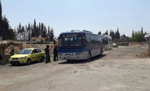 Buses evacuating the last Army of Islam operatives and their families from Duma