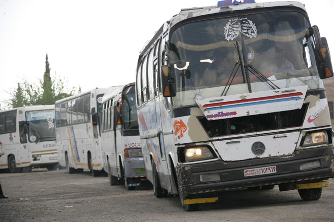 Buses evacuating the last Army of Islam operatives and their families from Duma (SANA, April 13, 2018)