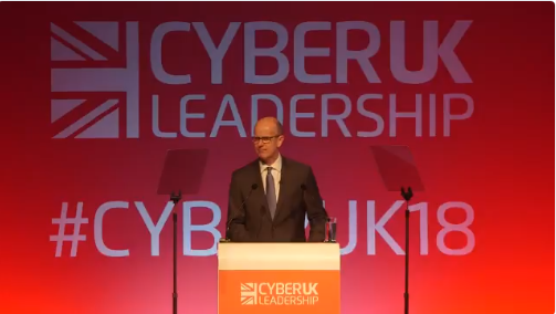 Jeremy Fleming, head of the British Government Communications Headquarters, at the CyberUK 2018 cyber conference in Manchester(Twitter account of the British National Cyber Security Centre, April 12, 2018)