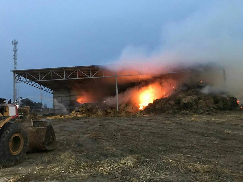 Fire in a hay storage structure in a community in the western Negev, caused by a Molotov cocktail flown in on a kite (Facebook page of Shehab, April 21, 2018).