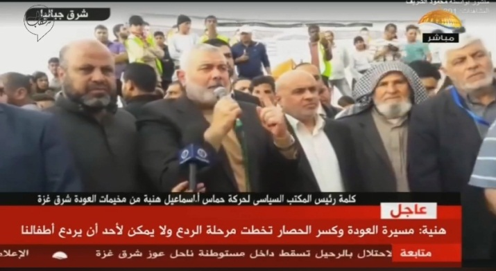 "Isma'il Haniyeh, head of Hamas' political bureau (second from left) delivers a speech in the ""return camp"" in the eastern part of Jabalia (Facebook page of Shehab, April 20, 2018)."
