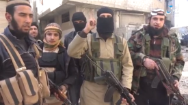 ISIS operatives in the Al-Qadam neighborhood after it was taken over from the Syrian Army. Left