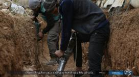 "ISIS operatives digging a trench in the Al-Qadam neighborhood (ISIS's Damascus Province as quoted on the ""Al-Yarmouk Camp in Our Hearts"" Facebook page, April 7, 2018)."