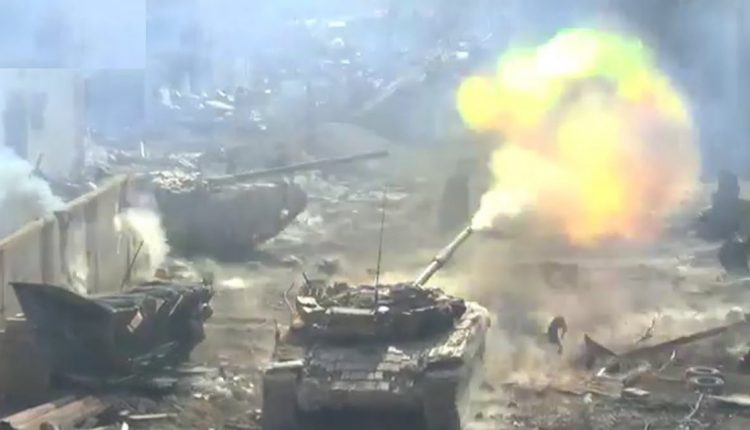 "Syrian tanks attacking centers and fortified positions of ""terrorist operatives"" in the Al-Hajar Al-Aswad neighborhood in south Damascus (Al-Hadath Suriya, April 24, 2018)"