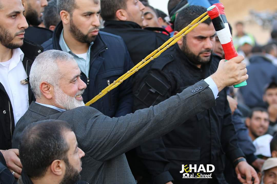 Message of violence: Chairman of Hamas's Political Bureau Ismail Haniya throwing stones at IDF forces during his visit to the march in east Rafah (PALINFO Twitter account, April 28, 2018)